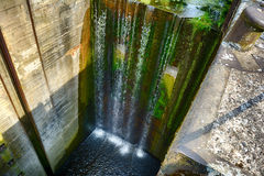 Fifteen meters waterfall on an abandoned river lock Stock Images