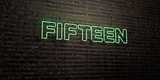 FIFTEEN -Realistic Neon Sign on Brick Wall background - 3D rendered royalty free stock image. Can be used for online banner ads and direct mailers Stock Photo