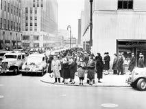 Fifth Avenue en 50ste Straat (Rockefeller-het Plein is op de linkerzijde), New York, NY, circa 1938 (Alle afgeschilderde personen Royalty-vrije Stock Foto's