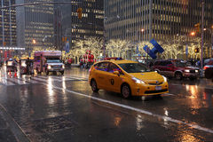 Fifth Avenue traffic in rainy weather, NYC, USA. Traffic on Fifth Avenue in rainy weather. Nyew York City, USA, December 2015 royalty free stock photography