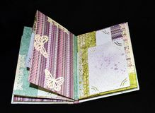 Fifth spread of a small handmade photoalbum royalty free stock photos