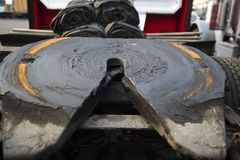 Fifth wheel with grease of big rig semi truck hitch. The Fifth wheel or other parts of big rig semi trucks are given great importance since trucks are the main stock image