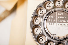 Fifties British vintage ivory telephone - macro dial detail. Fifties antique British GPO 332L ivory color bakelite telephone - macro shot of dial detail Royalty Free Stock Images