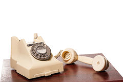 Fifties GPO vintage ivory telephone. Fifties antique British ivory color bakelite telephone GPO 332L - handset off Royalty Free Stock Photo