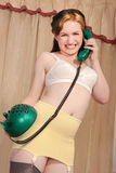 Fifties burlesque girl on telephone Stock Images