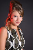 Fifties disco queen. Beautiful blond girl with fifties hairstyle ready for the disco Stock Images