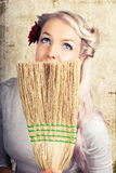 Fifties housewife daydreaming while cleaning Royalty Free Stock Photo