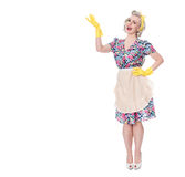 Fifties housewife indicating'special offer', humorous concept,. Isolated on white royalty free stock photos