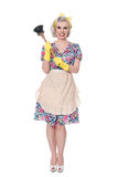 Fifties housewife with sink plunger, humorous concept, isolated. On white royalty free stock photo