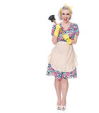 Fifties housewife with sink plunger, humorous concept, isolated. On white, space for text royalty free stock photography
