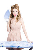 Fifties housewife woman ironing clothes Royalty Free Stock Images