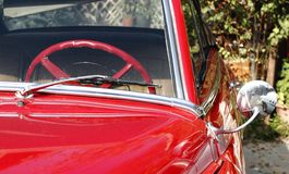 Fifties red american car. Partial front view of a 1950s american car Stock Photos
