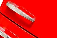 Fifties red fridge door close-up. Retro red fridge door close-up stock image Royalty Free Stock Photo