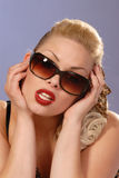 Fifties style beautiful girl in sunglasses Stock Photos