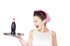 Fifties style female waiter serving up soda Stock Photography