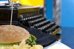 Fifties style - hamburger and typewriter Stock Photography