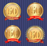 Fiftieth jubilee. Glossy emblems with banners and text Royalty Free Stock Photo