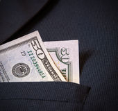 Fifty American dollars in my pocket men's jacket Royalty Free Stock Images