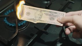 Fifty dollar banknote burning on lighted gas stove crazy russian power of Siberia stock footage