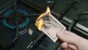 Fifty dollar banknote burning on lighted gas stove crazy russian power of Siberia stock video footage