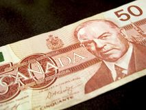 Fifty Dollar Banknote (Canadian). Close-up of a Canadian fifty dollar banknote on a black background Royalty Free Stock Image