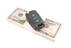 Fifty dollars banknotes and car alarm. On white Royalty Free Stock Photos