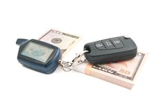 Fifty dollars notes and car keys. On white Stock Photography