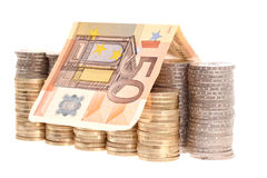 Fifty euro banknote and coins organized in columns Stock Photo