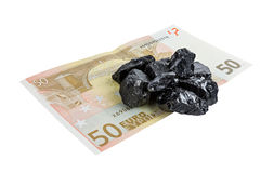 Fifty euro banknote whith raw coal nuggets Royalty Free Stock Images