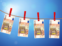Fifty euro banknotes on clothesline. Euro banknotes hanging on a clothesline against a sky Royalty Free Stock Photo