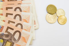 Fifty euro banknotes and coins Stock Photo