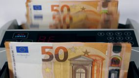 Fifty-euro banknotes are getting calculated rapidly. 4K stock video footage