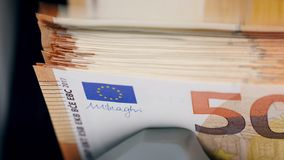 Fifty-euro banknotes are getting counted automatically. 4K stock video footage