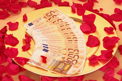 Fifty euro banknotes on a golden plate Royalty Free Stock Photo