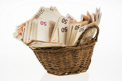 Fifty euro banknotes pile. Money bunch stack. Bill and brown basket. Euros heap stock image