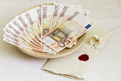 Fifty euro banknotes and wedding invitation Stock Image
