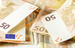 Fifty euro banknotes on white wooden background.  Royalty Free Stock Photography