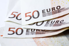 Fifty euro banknotes on white wooden background.  Royalty Free Stock Photos