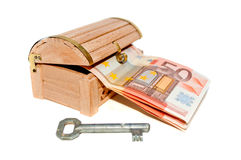 Fifty euro banknotes in the wooden chest and key Stock Image