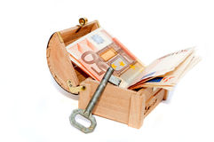 Fifty euro banknotes in the wooden chest and key Stock Photography