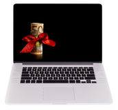 Fifty Euro Bill with Red Ribbon as a Gift on Laptop stock images
