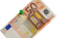 Fifty euro bill on a white board. Close-up of a fifty euro bill with push pin on a white board Royalty Free Stock Photos