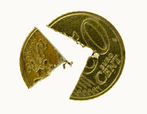 Fifty Euro-Cent coin cut into pieces. A fifty Euro-Cent coin cut into two pieces Stock Photos