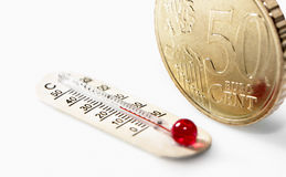 Fifty euro cent and thermometer Royalty Free Stock Image