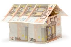 Fifty Euro House. Big House build of fifty euro bills, Isolated on a white background Royalty Free Stock Photo