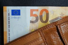 A fifty euro note in a leather wallet royalty free stock photography