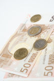 Fifty euro notes fanned with various Euro coins Royalty Free Stock Image