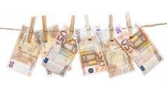 Fifty euro notes hanging Stock Photos