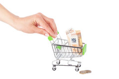 Fifty euro in the shopping pushcart, isolated. On white Royalty Free Stock Photo