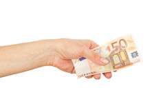 Fifty euro in the woman`s hand, light background Stock Photos